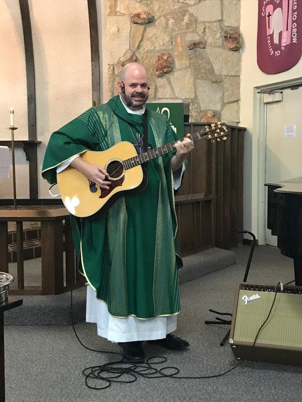 Pastor Steve Bogie playing guitar